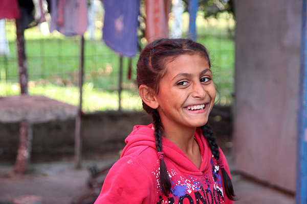 Portrait of Amela, nine year old who can't wait to start school